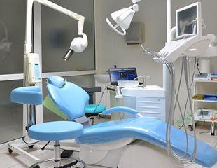 Идеальная улыбка! Ультразвуковая чистка, установка имплантов и брекетовв сети стоматологий BEST CLINIC со скидкой до 84%!